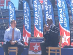 New Denver Broncos Head Coach Vance Joseph speaks to students at the Salute the Stars event about success